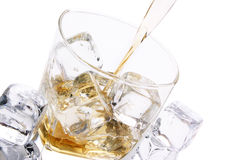 Cold glass of alcohol Stock Images