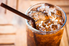 Cold glass with cola and ice Royalty Free Stock Photos