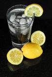 Cold glass of Ice water with Lemon. Royalty Free Stock Image