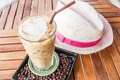 Cold glass of iced milk coffee on table Stock Photography