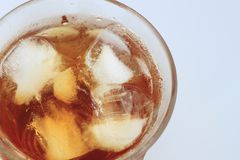 Cold glass of iced tea with ice Royalty Free Stock Photos