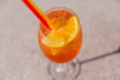 Cold glass of Rum swizzle stand on table. View from above royalty free stock image