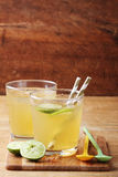 Cold gold soft drink from lime and honey Royalty Free Stock Photo