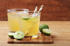 Cold gold soft drink from lime and honey Royalty Free Stock Photos