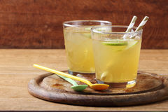 Cold gold soft drink from lime and honey Stock Images