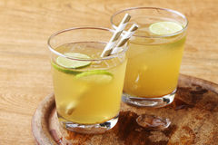 Cold gold soft drink from lime and honey Royalty Free Stock Photography