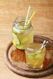 Cold gold soft drink from lime and honey Stock Photo