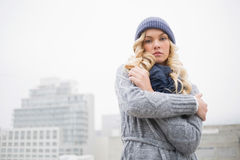 Cold gorgeous blonde posing outdoors Stock Photography
