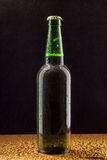 Cold green beer bottle on black Royalty Free Stock Photos