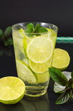 Cold green lime juice with ice cubes Stock Image