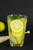 Cold green lime juice with ice cubes Royalty Free Stock Photo