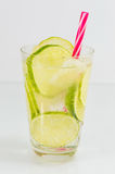 Cold green lime juice with ice cubes Stock Photo