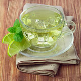 Cold green tea with ice cubes, lime sliced Royalty Free Stock Photo