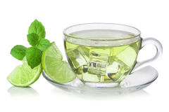 Cold green tea with ice cubes, lime sliced. And mint leaves royalty free stock photography