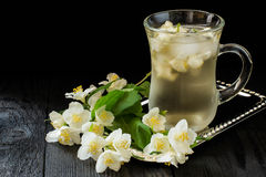 Cold green tea with jasmine and ice Stock Images