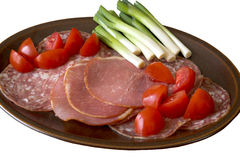 Cold Ham & tomatoes. Platter with cold meats, tomatoes and spring onions Stock Photos