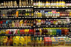 Cold healthy drinks on supermarket shelves Stock Photos