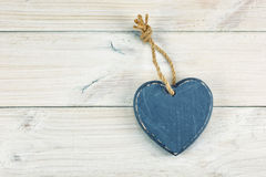 Cold heart on the wooden background. Royalty Free Stock Images