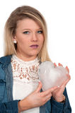 Cold Hearted Woman. Woman holding a heart made of ice Royalty Free Stock Photo