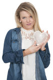 Cold Hearted Woman. Woman holding a heart made of ice Stock Photo