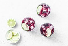 Cold hibiscus tea with ice on white background, top view. Stock Photo