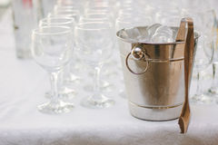 Cold ice in a bucket. Ice Bucket with tranparent cubes of ice Stock Photo