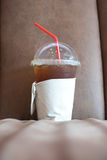 Cold Ice coffee on sofa. Lifestyle of worker and student royalty free stock image