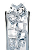 Cold ice cubes in the glass. Isolated on white background Royalty Free Stock Photos