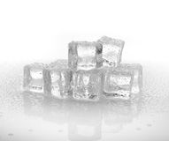 Cold ice cubes on the white background. Cold ice cubes on the white Royalty Free Stock Image