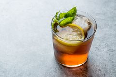 Cold Iced Tea Bergamot with Mint Leaves, Lemon and Ice. Summer Drink royalty free stock photography