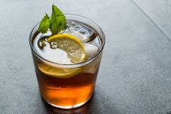 Cold Iced Tea Bergamot with Mint Leaves, Lemon and Ice. Summer Drink stock photo