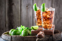Cold iced tea with ice cubes and mint Stock Images