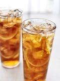 Cold iced tea with lemons. Stock Photos
