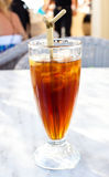 Cold iced tea with straw Stock Image