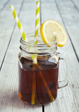 Cold iced tea with straws and lemon slices. Royalty Free Stock Images