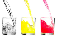 Cold juice and water. Cold yellow and red juices and water in three glasses Stock Photography