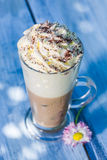 Cold latte with whipped cream Royalty Free Stock Photography