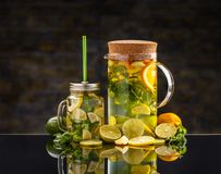 Cold lemon water. With fresh fruits in a jar and in a jug stock images