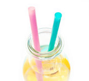 Cold lemon water in a  glass with two straws Stock Images