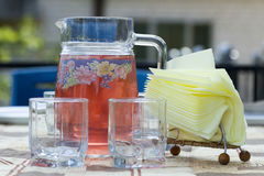 Cold lemonade with fresh strawberry, mint, lime and jam in glasses and jug. Healthy drink and summer refreshment concept. Copysp. Ace, top view Stock Images