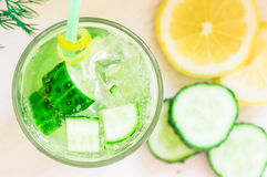 Cold lemonade with ice of fresh cucumber and lemon Stock Image