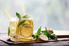 Cold lemonade with lemon wedges Stock Images