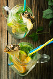 Cold lemonade with soda water, mint, orange and lemon in a jar Royalty Free Stock Photo