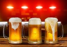 Cold light beer glass mug Stock Photos