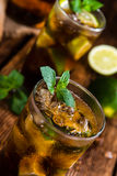Cold Longdrink (Cuba Libre). With brown rum and fresh lime on rustic wooden background royalty free stock photography