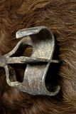 Branding Iron on Cow Hide. A cold looking branding iron on a cow hide for an abstract ranch or farm background Stock Photos