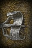 Branding Iron on Cow Hide in HDR. A cold looking branding iron on a cow hide done in hdr royalty free stock images