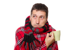 Cold man wrapped in blanket, holding mug Stock Images
