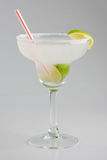Cold margarita cocktail. On gray background Royalty Free Stock Photos