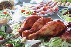 Cold meat buffet. Table featuring chicken drumsticks Stock Images